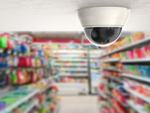 Überwachungskamera oder cctv-kamera an der decke mit ladenhintergrund