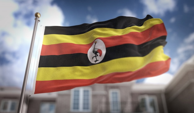 Uganda-flagge 3d-rendering auf blauem himmel gebäude hintergrund