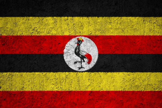 Uganda-flagge auf grunge-wand gemalt