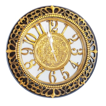 Uhr mit golddekor zeigt den ansatz des neuen jahres
