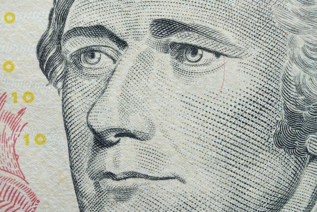 Ultra-makro-porträt von alexander hamilton auf 10-dollar-banknote.