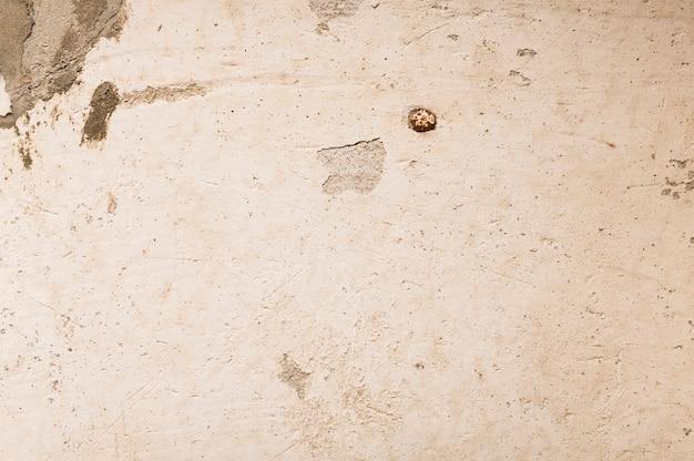 Unbedeutende schmutzige betonmauer