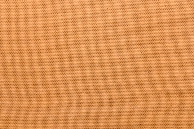 Unbedeutender orange gewebehintergrund