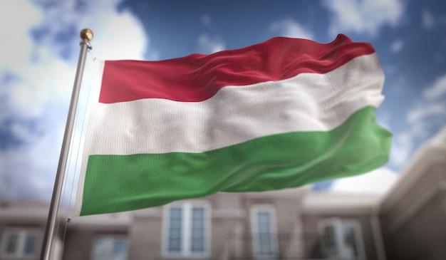 Ungarn flagge 3d rendering auf blauem himmel gebäude hintergrund