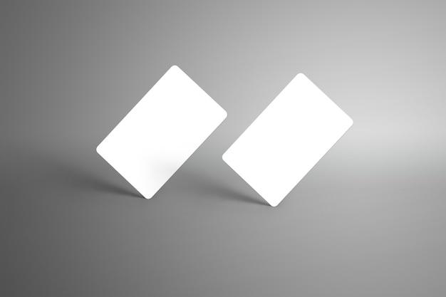 Universal zwei bankkarten (geschenkkarten) isoliert auf einer grauen oberfläche. bereit, in ihrem design verwendet zu werden.