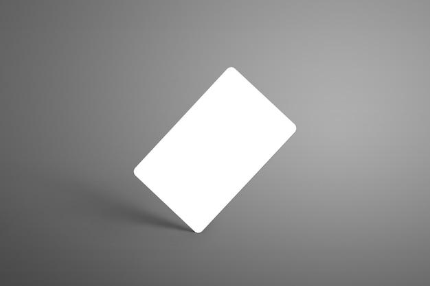 Universalbankkarte (geschenkkarte) auf einer grauen oberfläche, die an der ecke mit schatten steht. bereit, in ihrem design verwendet zu werden.