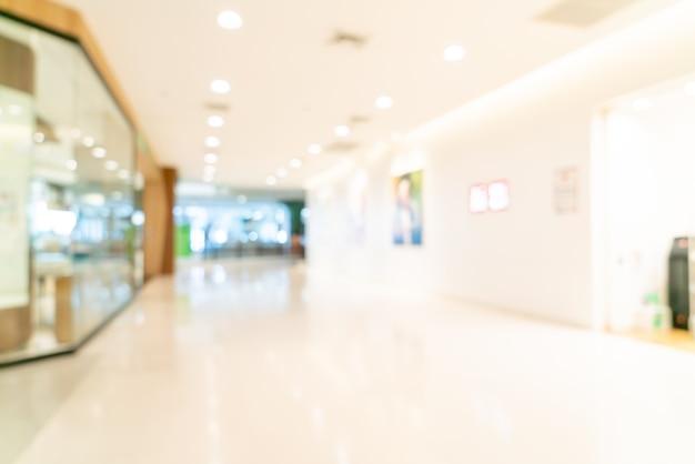 Unschärfe geschäfte und einzelhandelsgeschäfte im einkaufszentrum shopping