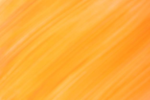 Unscharfer dunkelgelber und orangefarbener hintergrund mit linienmuster. defokussierte kunst abstrakter goldener farbverlaufshintergrund mit unschärfe und bokeh. verschwommene bernsteintapete.