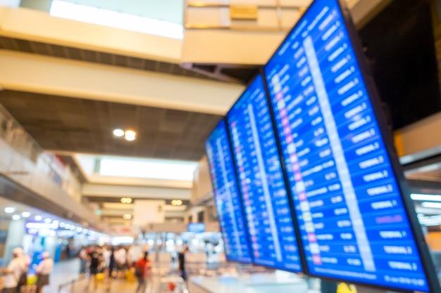 Unscharfer hintergrund des inneren flughafens, reisekonzept