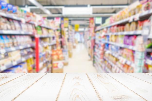 Unscharfer hintergrund des supermarktgeschäfts.