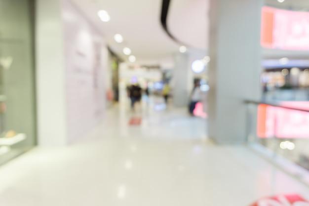 Unscharfer hintergrund - speicher des einkaufszentrumsunschärfehintergrundes mit bokeh. jahrgang gefiltertes bild.
