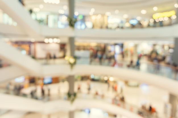 Unscharfer hintergrund - speicher des einkaufszentrumunschärfehintergrundes mit bokeh. weinlese gefiltertes bild.