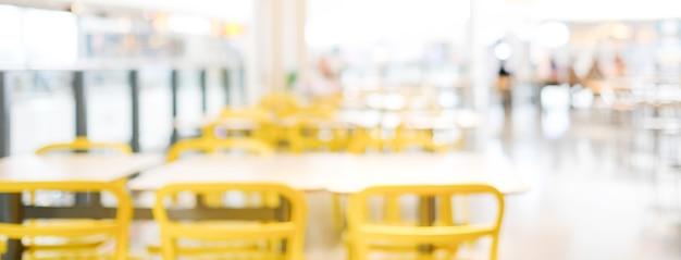 Unscharfer hintergrund: unschärfe-café mit bokeh-lichthintergrund, banner, speisen- und getränkekonzept