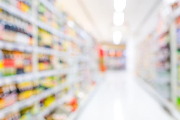 Unscharfer hintergrund, verwischungslebensmittelgeschäftsupermarkt am einkaufszentrumhintergrund