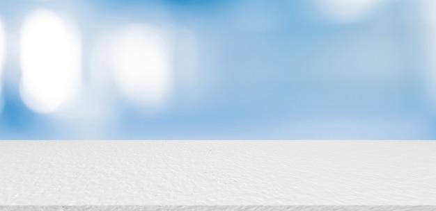 Unscharfer moderner innenbadezimmerhintergrund mit weißer marmormustertischplatte