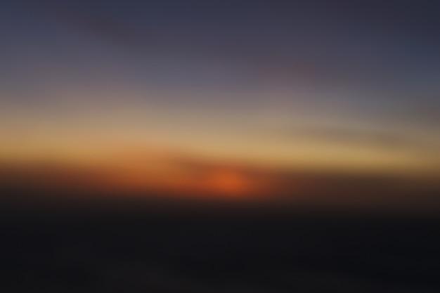 Unscharfer sonnenunterganghimmelhintergrund