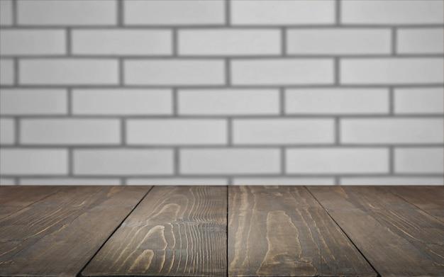 Unscharfer und abstrakter hintergrund leere holztischplatte und defokussierter backsteinmauerhintergrund für