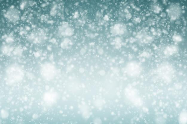 Unscharfes snowy-weihnachtsneues jahr feiern hintergrund-blau-ton