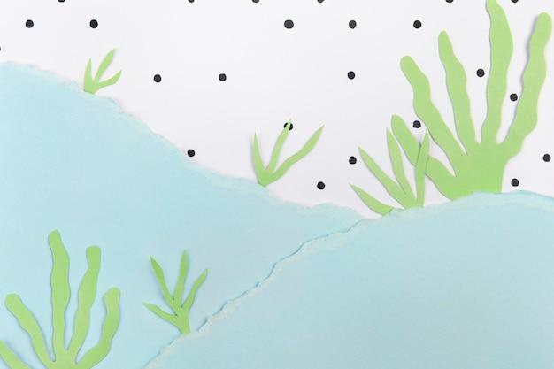 Unter dem meereshintergrund mit diy-papiercollage