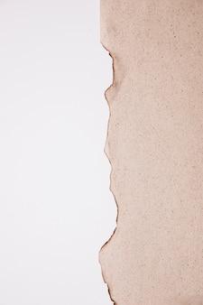 Unterbrochener papierbeschaffenheitshintergrund