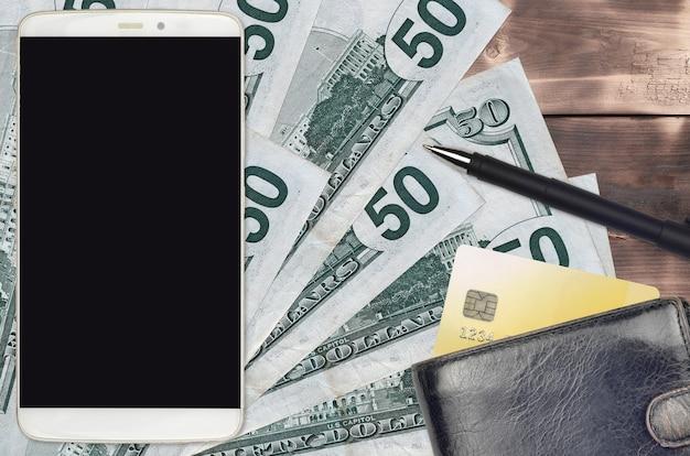 Us-dollar-scheine und smartphone mit geldbörse und kreditkarte