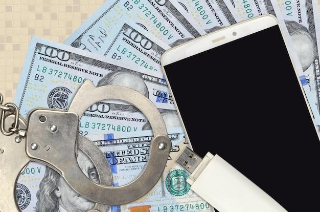 Us-dollar-scheine und smartphone mit handschellen der polizei