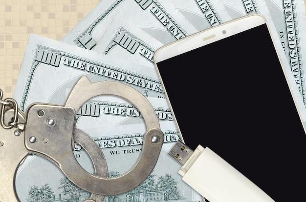 Us-dollar-scheine und smartphone mit polizeihandschellen