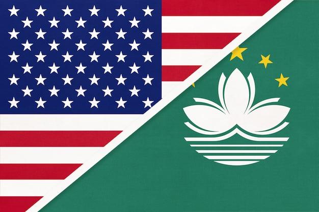 Usa gegen macao-staatsflagge vom gewebe. beziehung zwischen zwei amerikanischen und asiatischen ländern.