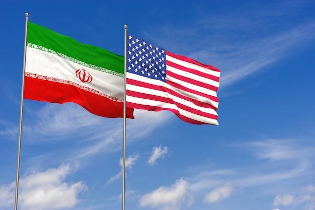 Usa und iran-flaggen über hintergrund des blauen himmels. 3d-darstellung