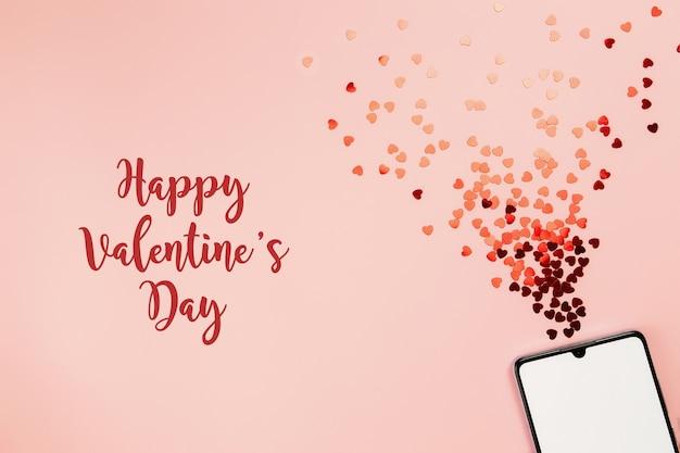 Valentinskarte mit leerem telefonbildschirm und glitzer. alles gute zum valentinstag text. hochwertiges foto