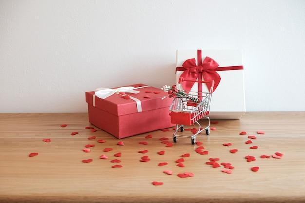 Valentinstag anwesend geschenkbox und rotes band für romantische paare.