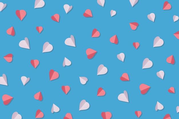 Valentinstag-begrüßungskonzept mit roten und rosafarbenen herzen auf blauem hintergrund draufsicht mit kopienraum für den text
