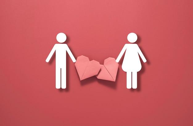 Valentinstag-konzept, rotes herz mit mann- und frauensymbol auf rotem hintergrund.