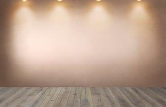 Verblaßte orange Wand mit einer Reihe von Scheinwerfern in einem leeren Raum
