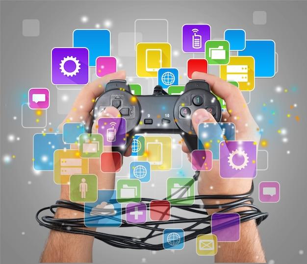 Verdrahtete hände mit joypad bedeutet videospielsucht