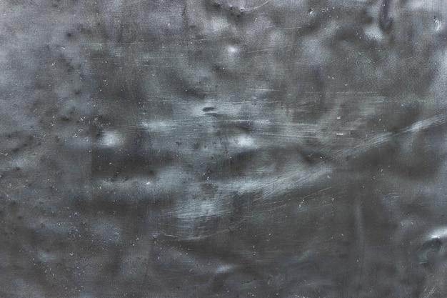 Verdrehtes blech der alten metallbeschaffenheit, verwitterte stahlplattenwand