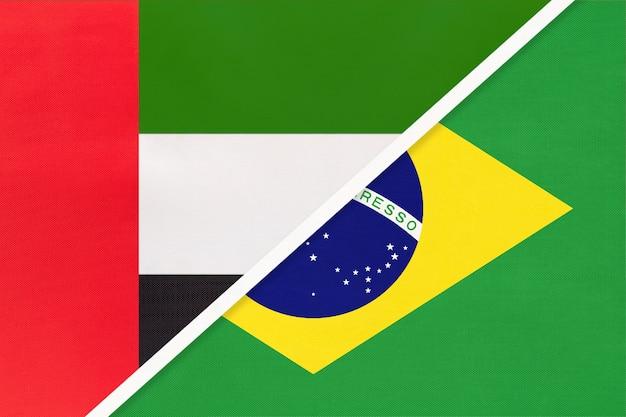 Vereinigte arabische emirate oder vereinigte arabische emirate und brasilien, symbol für zwei nationalflaggen aus textil.