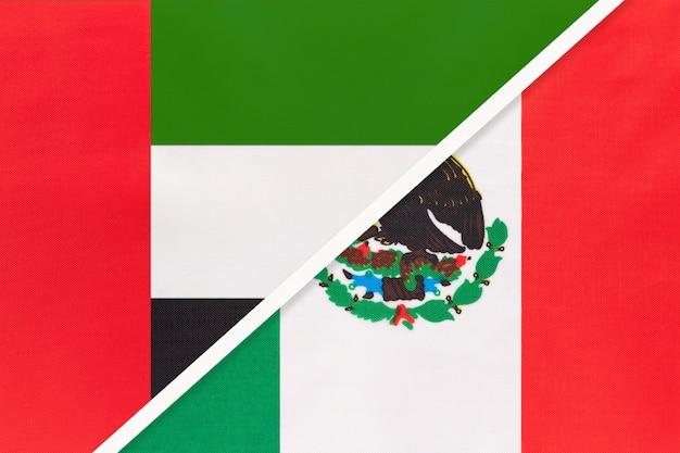 Vereinigte arabische emirate oder vereinigte arabische emirate und mexiko, symbol für zwei nationalflaggen aus textil.