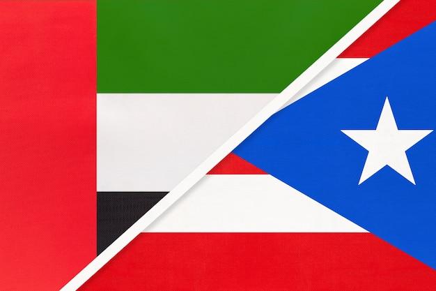 Vereinigte arabische emirate oder vereinigte arabische emirate und puerto rico, symbol für zwei nationalflaggen aus textil.