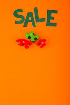 Verkaufsbeschriftung des papiers auf orange hintergrund