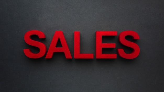 Verkaufskonzept auf schwarzem hintergrund