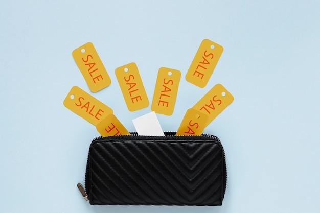 Verkaufszeichen, die aus reißverschlussgeldbörse herauskommen