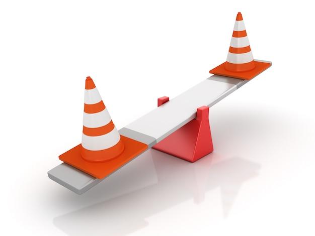 Verkehrskegel, die auf einer wippe balancieren