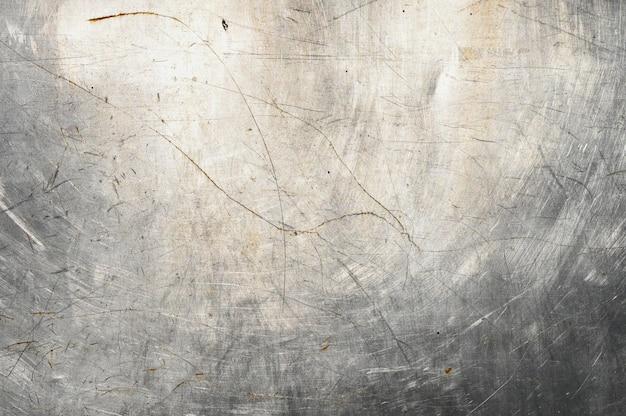 Verkratzter metallhintergrund. gegossene farbe. metallstruktur