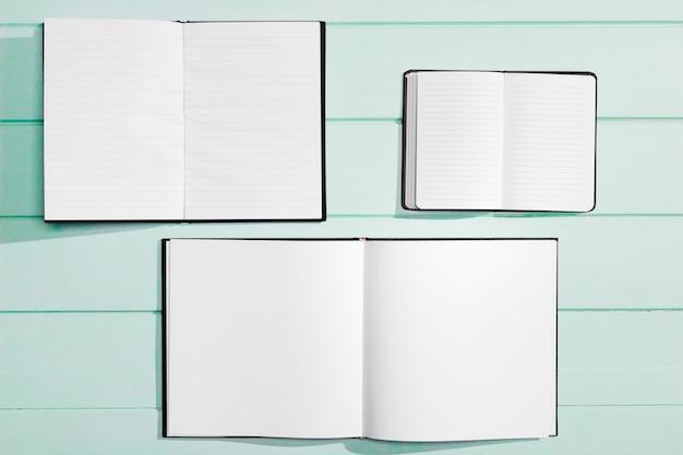 Verschiedene entwürfe für leere notizbücher des kopienraumes