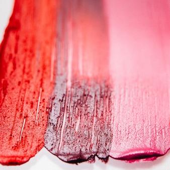 Verschmierter lippenstift. schönheitskunstgeschäft. muster für strukturierte striche. dekorativer hintergrund.