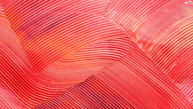 Verschmierter roter orange matter lippenstiftbeschaffenheit fester hintergrund