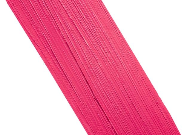 Verschmiertes magenta rosa mattes lippenstiftmuster lokalisiert auf weißem hintergrund