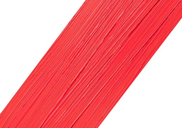 Verschmiertes rotes mattes lippenstiftmuster lokalisiert auf weißem hintergrund