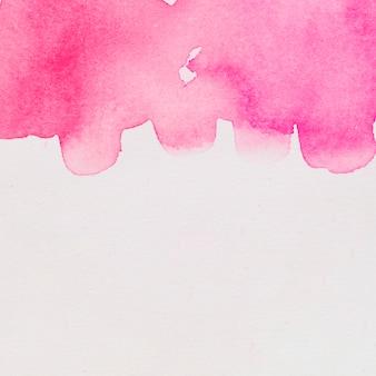Verschütten von rotem aquarell